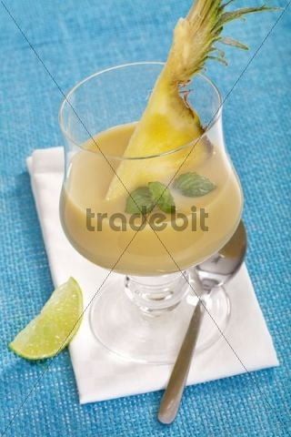 Pineapple-banana smoothie with pineapple pieces