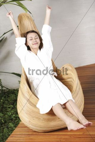 Young Asian woman relaxing in a chair