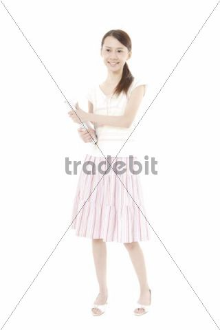 Young Asian woman holding books