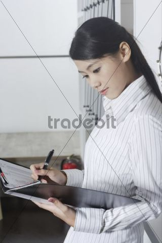 Young Asian woman holding a folder