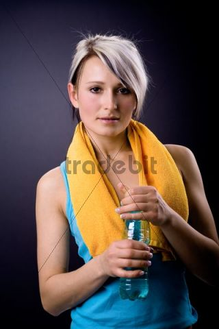 Young athlete with a bottle of water