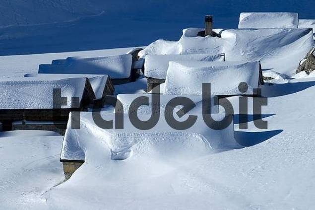 snow covered alp huts, Alps, Switzerland