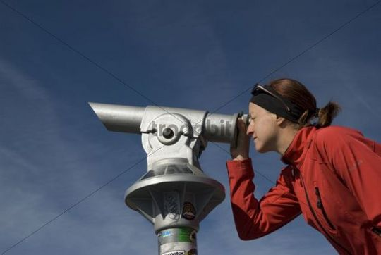 Woman looking through telescope - Download People
