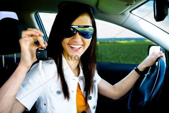 Young woman driving a new car