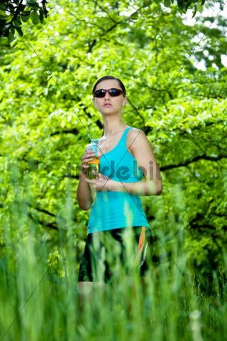 Young woman drinking after a run