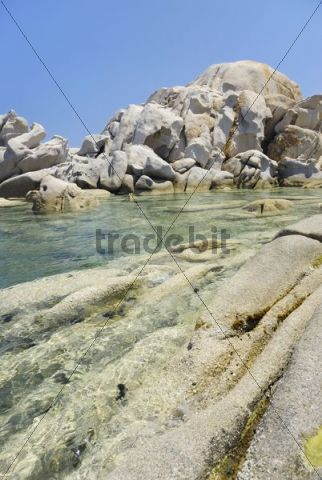 Bizarre, weathered granite rock boulders in crystal-clear turquoise water at the coast, Capo Ceraso, Sardinia, Italy, Europe