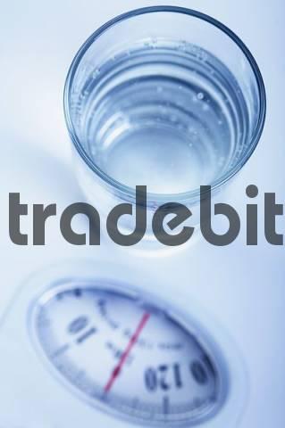 water glass on a balance