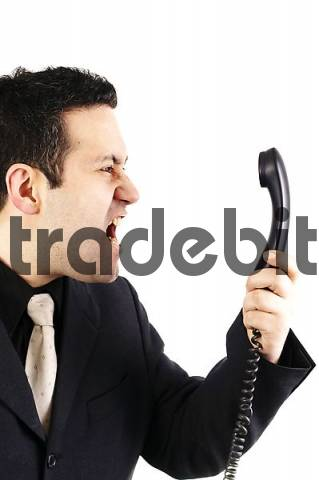 Businessman crying in phone