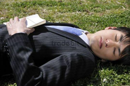 Businessman resting in park