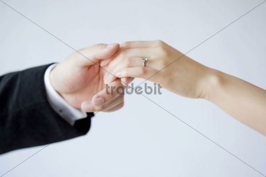 Young couple´s hands, wedding ring