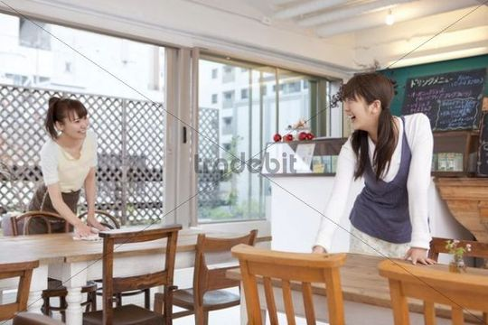 Young women working in coffee shop