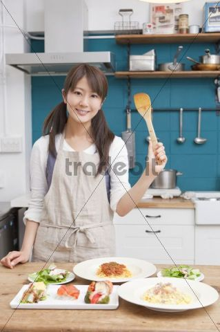Young woman working in kitchen