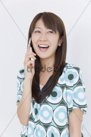 Young woman making a call on her mobile phone