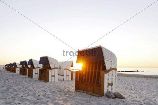 Roofed wicker beach chairs, beach, Baltic Sea, sunset, seaside resort of Ostseeheilbad Heiligendamm, Mecklenburg-Western Pomerania, Germany, Europe