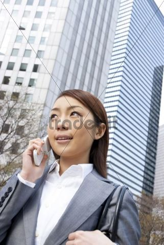 Businesswoman making a call on her mobile phone