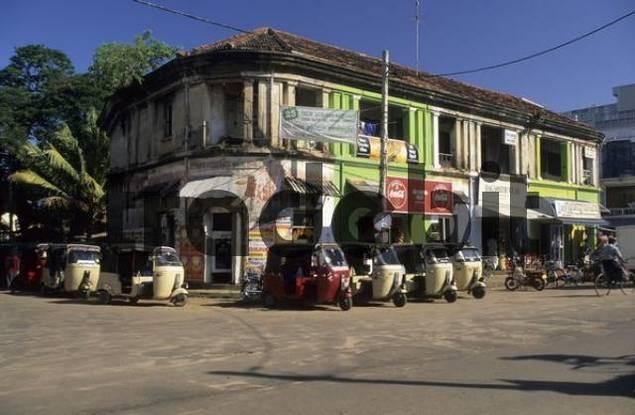 streetscape with treewheeler taxis in Negombo, Sri Lanka