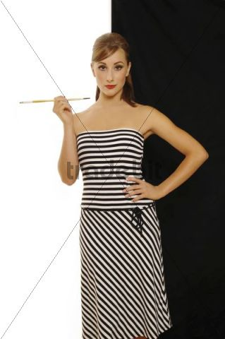 Women in a 60s look with cigarette holder