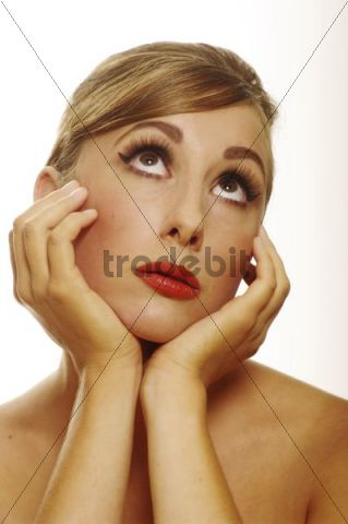 Women in a 60s look looking up expectantly