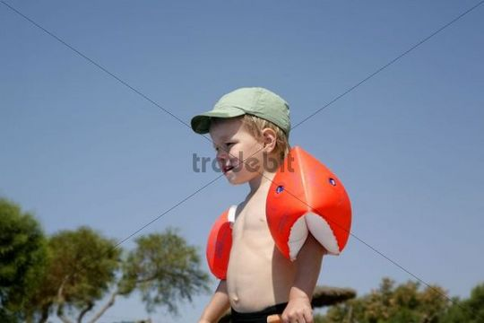 Three-year old boy with water wings