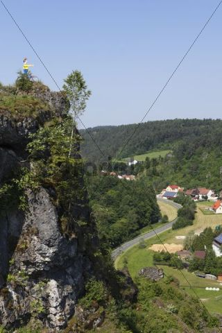 Cliff with a cyclist sculpture above Oberailsfeld, Ailsbachtal Valley, Franconian Switzerland, Franconian Alb, Upper Franconia, Franconia, Bavaria, Germany, Europe