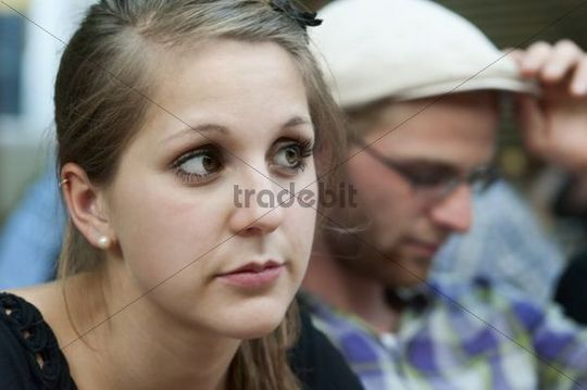 A young man and a young woman looking a bit bored, Germany, Europe