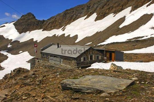 Monte Leone Hut, Swiss Alpine Club hut surrounded by fields of snow in the spring, Pennine Alps, Valais, Switzerland, Europe