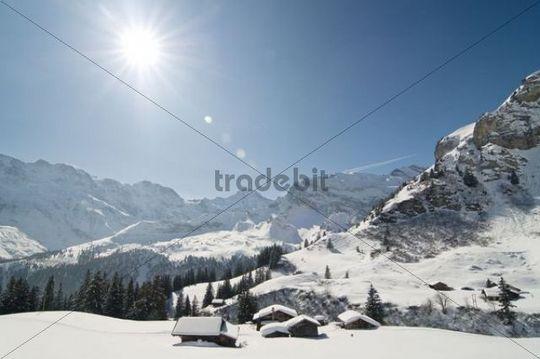 Mountain panorama with the sun, Muerren, Canton Bern, Switzerland, Europe