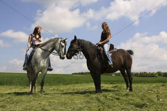 Two young women riding on horseback, Bavaria, Germany, Europe