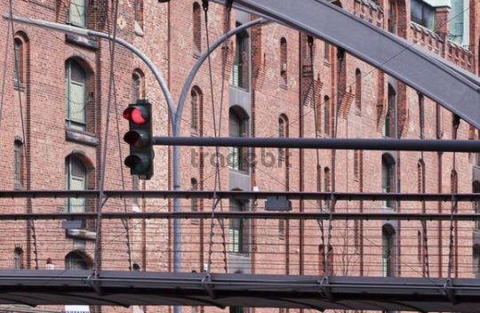 Pedestrian bridge with traffic lights in the Speicherstadt historic warehouse district in Hamburg, Germany, Europe