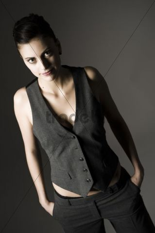 Young woman in androgynous clothes