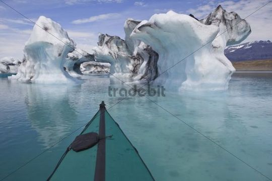 Folding kayak on the Joekulsarlon glacial lake, Iceland, Europe