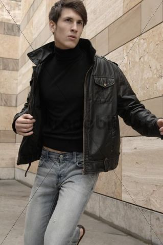 Man wearing a leather jacket, running