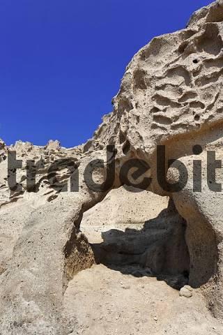 a rock gate at the beach Ormos Vlichada, Vlichada, Santorini, Greece