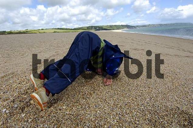 boy on the beach at Slapton Sands South Devon England