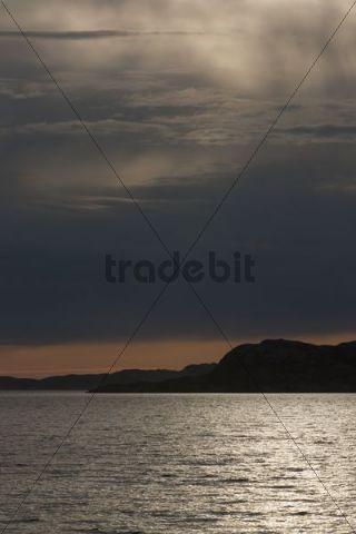 Reflections of the sun at dusk, Rodoyfjorden, Norway, Scandinavia, Europe