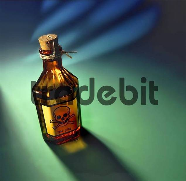 bottle of poison with yellow sticker on green background