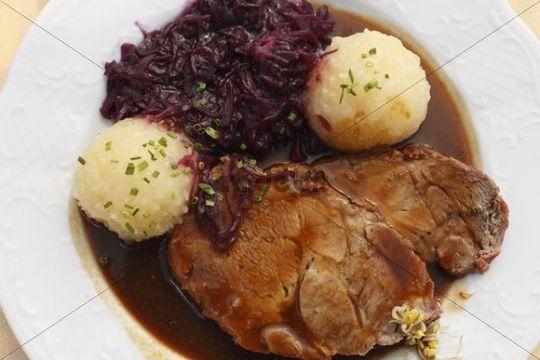 Schweinsbraten, roast pork with dumplings and red cabbage, Upper Bavaria, Bavaria, Germany, Europe