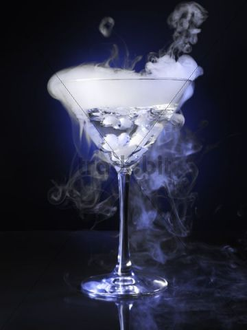 exotic drink in a martini glass with smoke coming out of it downl. Black Bedroom Furniture Sets. Home Design Ideas