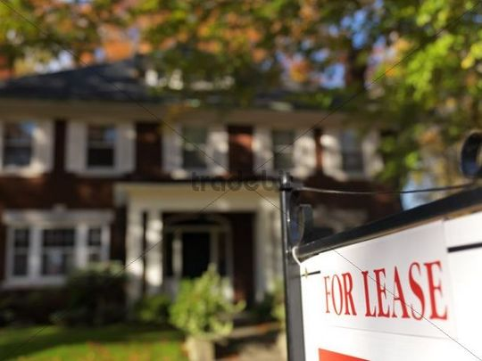"""For lease"" sign in front of a large house in fall, Toronto, Ontario, Canada"