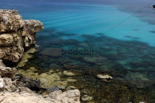 Crystal clear water and a rocky seashore of the Mediterranean Sea, Cape Gkreko, Cyprus