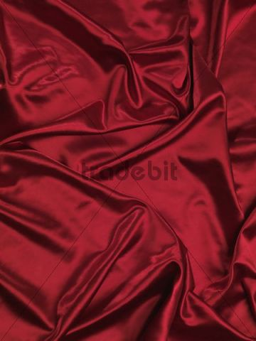 Red shiny silky fabric, background