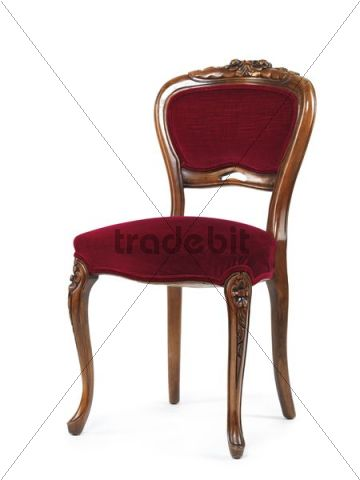Antique wooden chair with red upholstery