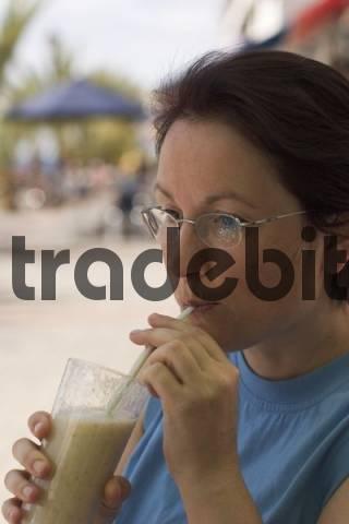 - woman drinking juice in La Playa - Valle Gran Rey - La Gomera