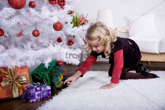 Little girl choosing a Christmas gift
