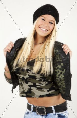 Young woman with long blond hair posing while wearing a jacket, a military-top