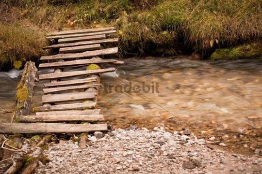 Small wooden bridge over a brook