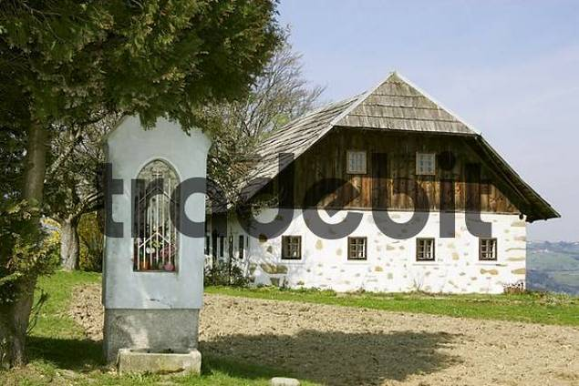 farmhouse and a devoutional picture in a small stone building in the Mostviertel Lower Austria