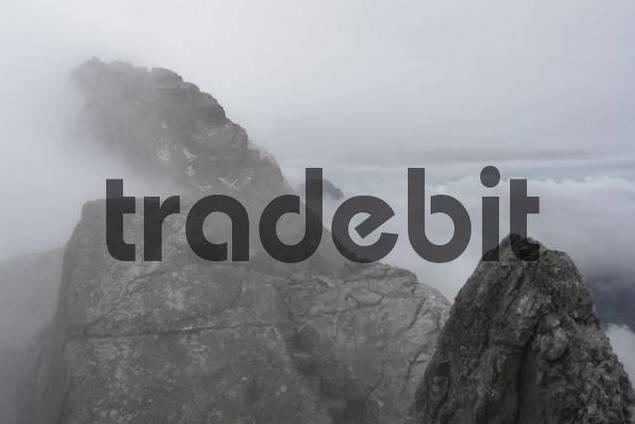 Foggy view from Watzmann/Hocheck to Mittelspitze, Bavaria, Germany