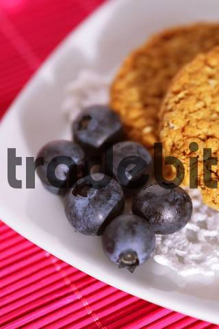 Healthy snack with blueberries and full corn biscuits - close up