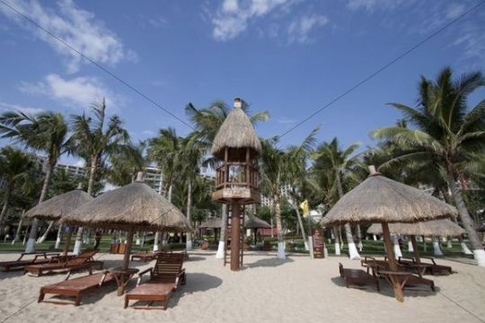 Sun beds and sunshades on the beach, Hainan Province, China, Asia